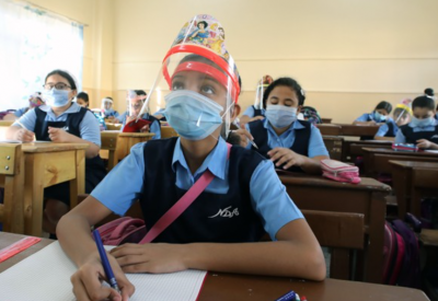 Students attending school wearing PPE